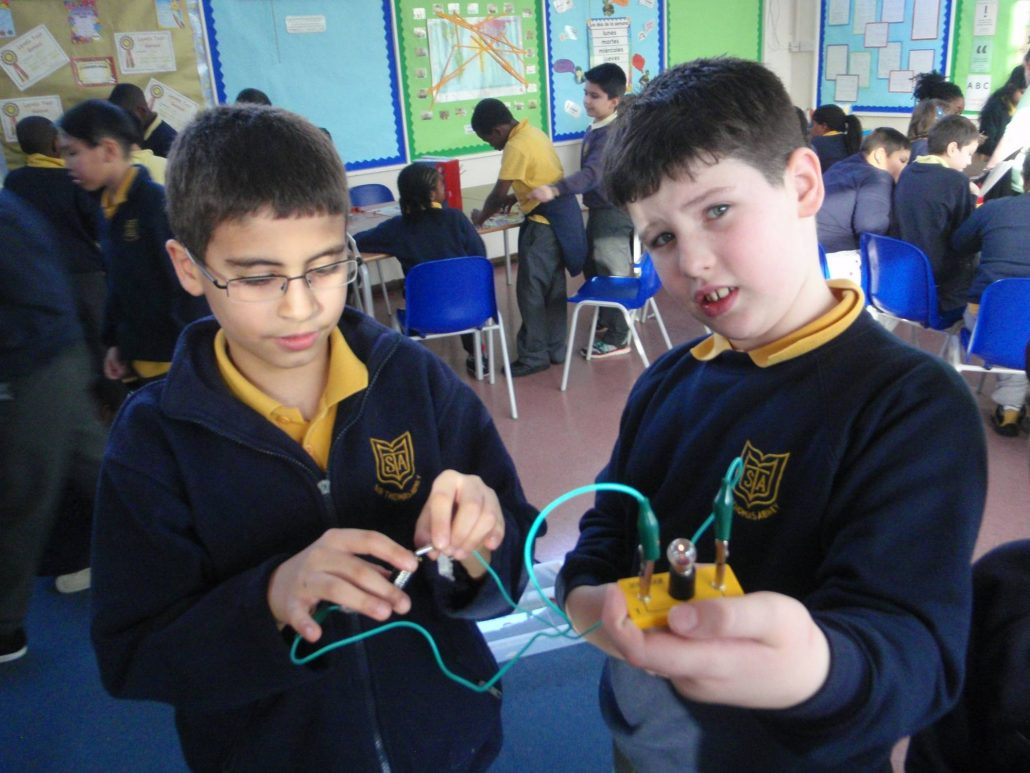 Children doing a science experiment with electrical circuits