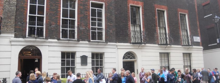 Queue of people on the street outside Benjamin Franklin House