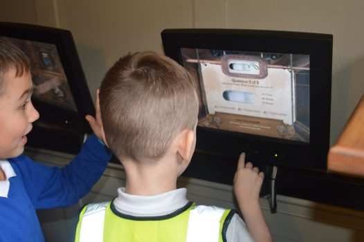 Children playing on the tablets in the Student Science Centre