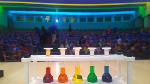 Rainbow liquids in test tubes on stage