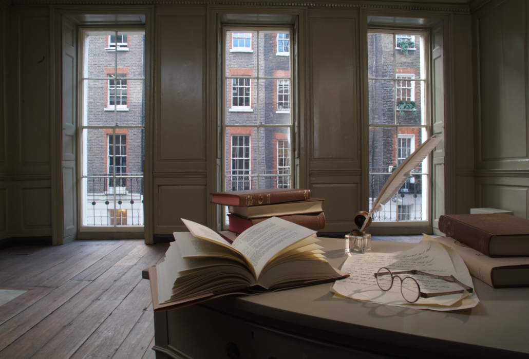 Books and bifocals on a desk in Franklin's parlour