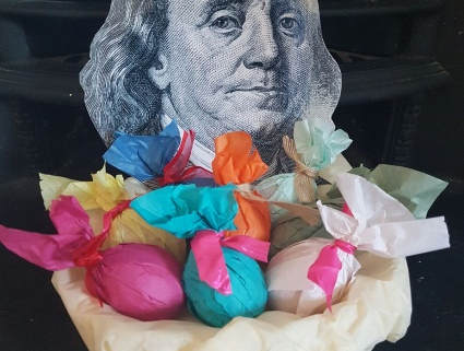 Eggs wrapped in colourful tissue paper with ribbon ties