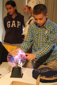 Students playing with a plasma ball