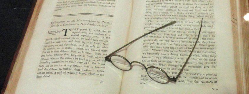 Bifocals left on an open book