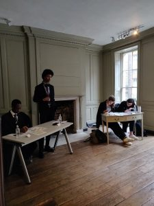 Students in Franklin's parlour at a debate competition