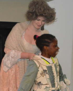 Child dressing up in historical costume