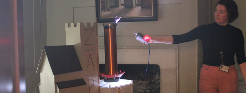 Mini Tesla coil being fired with blue lightning