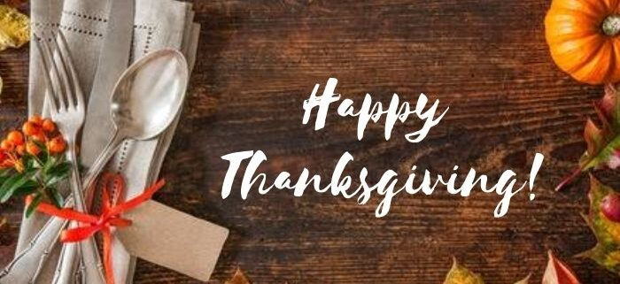 Happy Thanksgiving graphic with pumpkins and autumnal leaves