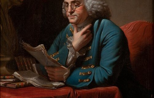 Portrait of Benjamin Franklin by David Martin, reading a paper, wearing a powdered wig