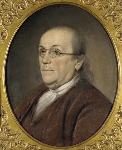 Portrait of Benjamin Franklin, looking off into the distance in a gold frame