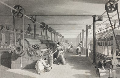 Women and children operating textile machinery. The machines were connected via belts to a steam engine which provided the power.